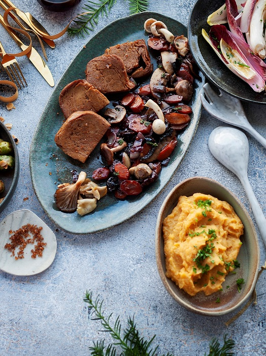 Festively set table with seitan in the lead