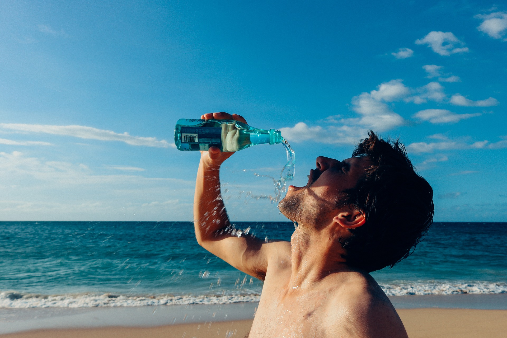 man drinks water after exercise